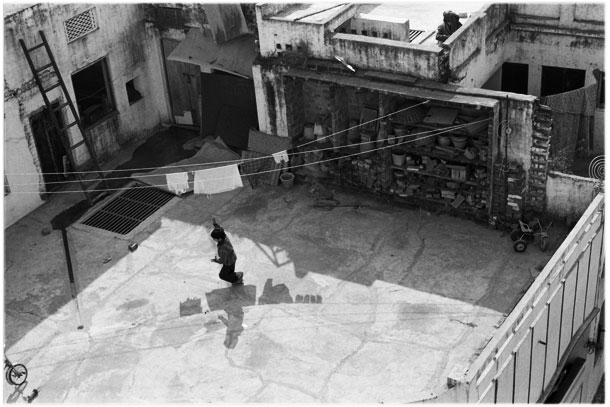 Child playing with a kite in Varanasi, India